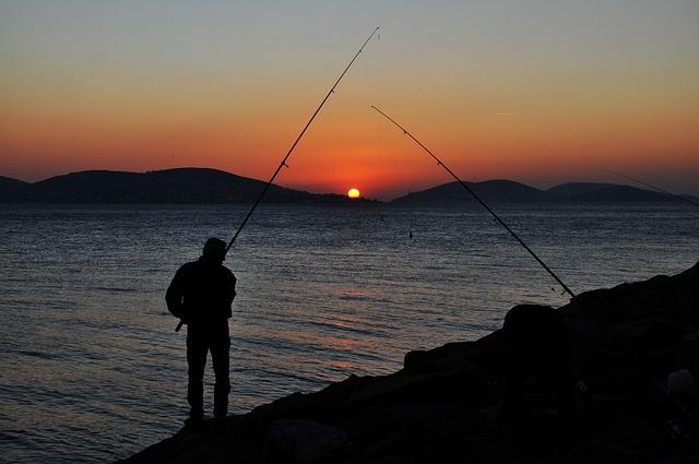 rybáři ve tmě